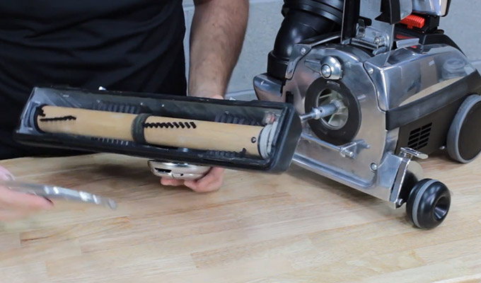 Changing the Belt of the Vacuum